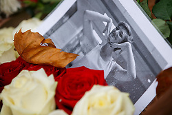 © Licensed to London News Pictures. 17/11/2015. Paris, France. Flowers and pictures of victims left a memorial outside Bataclan cafe in Paris, France following the Paris terror attacks on Tuesday, 17 November 2015. Photo credit: Tolga Akmen/LNP