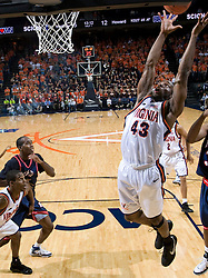Virginia guard-forward Will Harris (43) grabs a rebound in the first half.  The Virginia Cavaliers men's basketball team faced the Howard Bison at the John Paul Jones Arena in Charlottesville, VA on November 14, 2007.