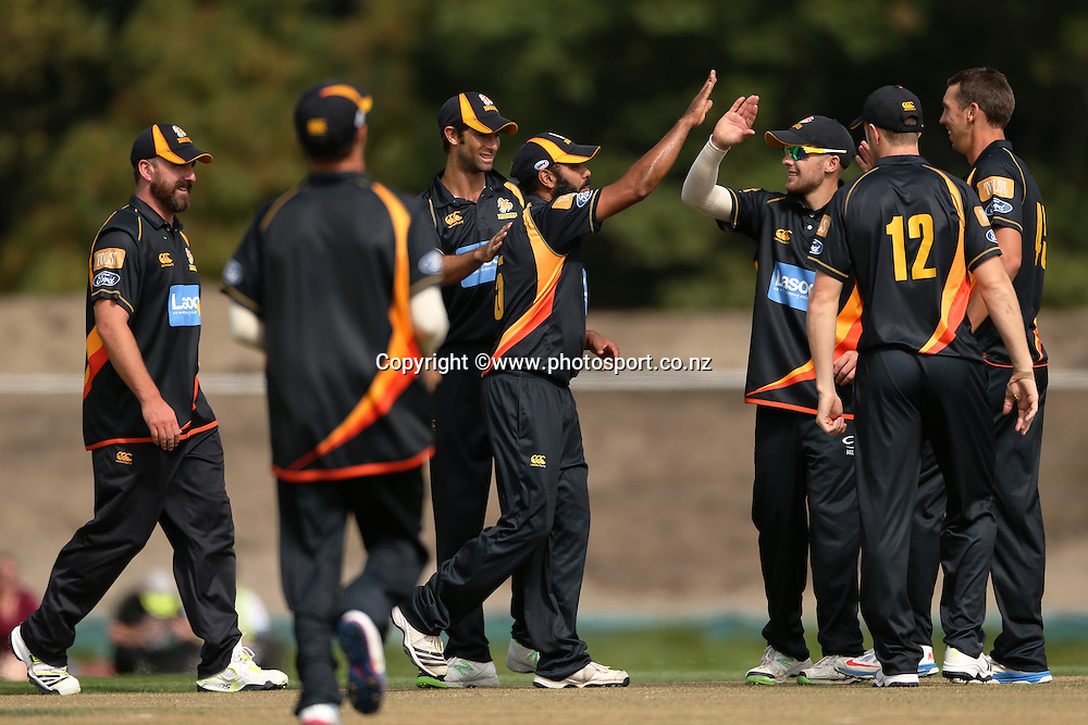 Jeetan Patel (c) of the Firebirds celebrates with team mates a catch to dismiss Todd Astle of the Wizards during the Preliminary Final in the Ford Trophy One-Day cricket match between the Canterbury Wizards v Wellington Firebirds at Hagley Oval, Christchurch. 2 April 2014 Photo: Joseph Johnson/www.photosport.co.nz