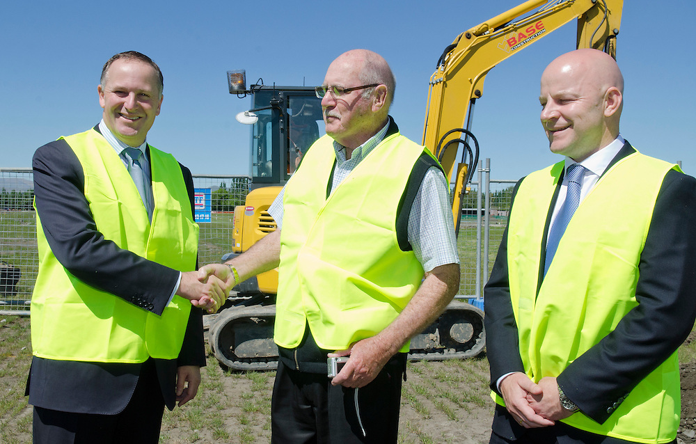 Rebuild resident Cliff Mitton flanked by Prime Minister John Key, left, and National Party candidate for Christchurch East  Matthew Doocey on a visit to Prestons residential development in Marshlands, Christchurch, New Zealand, Thursday, October 31, 2013. Credit: SNPA /  David Alexander.