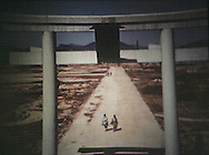 The only gate left standing in the Hiroshima hypocenter...Frame grabs for US Armed Forces  16mm color film shot in Hiroshima days after the bombing of Hiroshima.