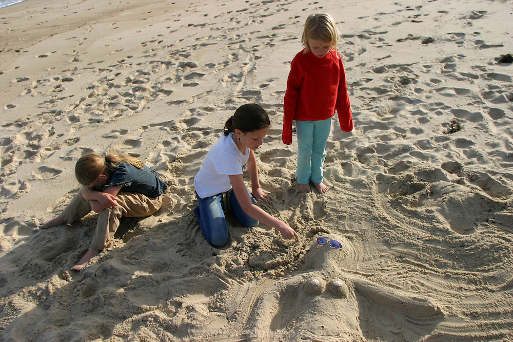 Mermaid sand sculpture on the beach at Martha's Vineyard, Massachusetts. MODEL RELEASED.