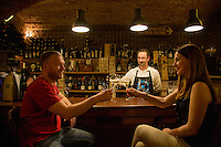 Zagreb, Croatia- May 5, 2015: Friends enjoy a glass wine at Vinoteka Bornstein, the first private wine shop of the former Yugoslavia. The 19-century wine cellar, located in historic Kaptol, offers a large selection of wines CREDIT: Chris Carmichael for The New York Times