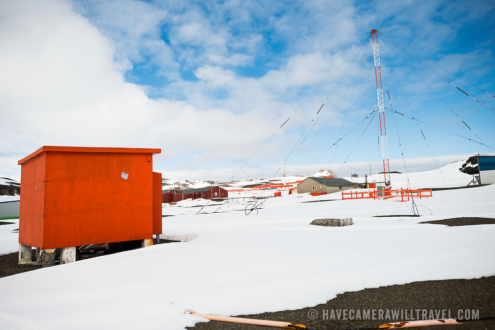 Buildings and a large radio antenna at Bellingshausen Station, a Russian scientific research base on King George Island in Antarctica.