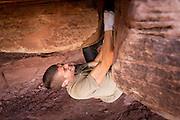 Kevander Baldwin fighting for a fist jam in a roof crack.<br /> Crack House, Moab.