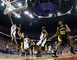 Virginia Cavaliers forward Adrian Joseph (30) shoots over Albany Great Danes forward Brian Connelly (33).  The #4 seed Virginia Cavaliers defeated the #13 seed Albany Great Danes 84-57 in the first round of the South Region Men's NCAA Tournament in Columbus, OH on March 16, 2007.