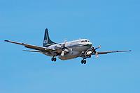 Saskatchwan Convair 580A waterbomber landing at Whitehorse, Yukon.