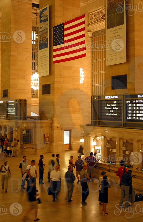 Aug 16, 2002; New York, NY, USA; Commuters line up to buy a ticket to travel on the Harlem Line in Grand Central Station.  American Flags hang over every enterance in the the terminal.  Mandatory Credit: Photo by Shelly Castellano/ZUMA Press. (©) Copyright 2002 by Shelly Castellano