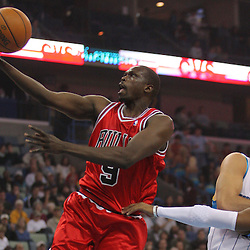 Jan 29, 2010; New Orleans, LA, USA; Chicago Bulls forward Luol Deng (9) shoots past New Orleans Hornets forward Peja Stojakovic (16) and guard Chris Paul (3) during the first half at the New Orleans Arena. Mandatory Credit: Derick E. Hingle-US PRESSWIRE