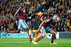Mohamed Diame of Hull City, playing against his former club on his debut, watches as his shot goes in for a goal Hull City's record new signing Abel Hernandez, making his club debut, scores his second goal of the game - Photo mandatory by-line: Rogan Thomson/JMP - 07966 386802 - 15/09/2014 - SPORT - FOOTBALL - KC Stadium, Hull - Hull City v West Ham United - Barclays Premier League.