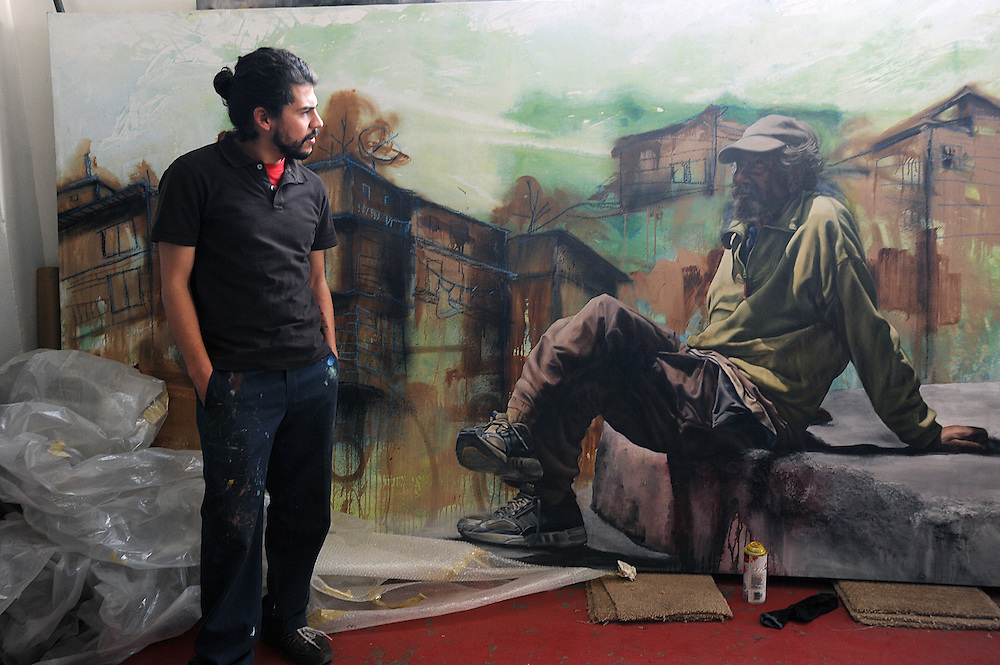 The artist Alfredo Gutierrez with his portrait of an American homeless man in Tijuana, Baja California, Mexico.<br /> <br /> &copy; Stefan Falke<br /> www.stefanfalke.com<br /> La Frontera: Artists along the US Mexican Border
