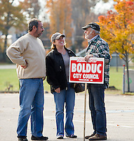 Jose and Stacie DeMatos talk with Armand Bolduc Ward 6 City Councilor candidate prior to voting at Leavitt Park on Tuesday morning.   (Karen Bobotas/for the Laconia Daily Sun)