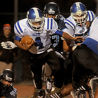 Scotland's Dashaun Ferguson rushes against Hoggard Friday November 28, 2014 at Hoggard High School in Wilmington, N.C. (Jason A. Frizzelle)