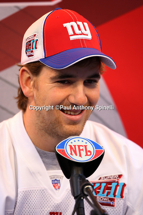 GLENDALE, AZ - JANUARY 29: Quarterback Eli Manning #10 of the New York Giants smiles as he speaks to the media at the Giants Super Bowl XLII Media Day at University of Phoenix Stadium on January 29, 2008 in Glendale, Arizona.©Paul Anthony Spinelli *** Local Caption *** Eli Manning
