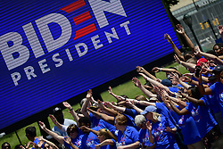 Supporters cheer as former Vice President Joe Biden takes the stage to kick off his 2020 campaign in the US Presidential Election, at an outdoor rally on the Benjamin Franklin Parkway in Philadelphia, PA on May 18, 2019.