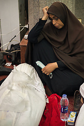 60360915 <br /> An Egyptian woman stares at a dead body at a mosque where lines of bodies wrapped in shrouds were laid out in Cairo, Egypt, August 15, 2013. At least 525 were killed and 3,717 others injured across Egypt in clashes between supporters of ousted President Mohamed Morsi and the security troops, after the latter dispersed Wednesday two major pro-Morsi sit-ins in Cairo and Giza, a Health Ministry official said Thursday, August 15, 2013. <br /> Picture by imago / i-Images<br /> UK ONLY