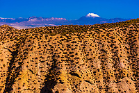 Badlands, seen from the Mirador Cueva los Amos viewpoint with snowcapped La Sagra peak in background, near Galera,Granada Province, Andalusia, Spain.