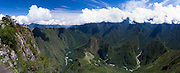 The Incan ruins of Machu Picchu and the small mountain, Huayna Picchu, photographed from atop Montaña Machu Picchu, near Aguas Calientes, Peru. Aguas Calientes is in the river valley as the river curves out of view on the right.