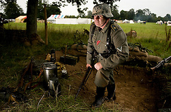 © Licensed to London News Pictures. 06/08/2011.Broadlands. Hampshire. Johanne Ritter (Re-enactment name) takes part in the German army display during Blasts from the Past. Classic battles, re-enactments and displays of military skirmishes throughout history took place at the Broadlands display grounds during the Blast from the Past event today. Photo credit : Ian Forsyth/LNP