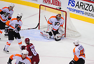 Dec. 3 2011; Glendale, AZ, USA; Philadelphia Flyers goalie Ilya Bryzgalov     (30) blocks a goal while playing against the Phoenix Coyotes during the third period at Jobing.com Arena. The Flyers defeated the Coyotes 4-2. Mandatory Credit: Jennifer Stewart-US PRESSWIRE.