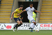 AFC Wimbledon forward Lyle Taylor (33) holds the ball up during the Sky Bet League 2 match between Oxford United and AFC Wimbledon at the Kassam Stadium, Oxford, England on 10 October 2015.