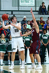 17 November 2017:  Alex O'Neill takes the baseline guarded by Zach Sinke during an College men's division 3 CCIW basketball game between the Alma Scots and the Illinois Wesleyan Titans in Shirk Center, Bloomington IL