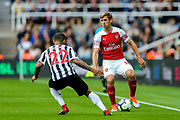 Nacho Monreal (#18) of Arsenal looks to take on DeAndre Yedlin (#22) of Newcastle United during the Premier League match between Newcastle United and Arsenal at St. James's Park, Newcastle, England on 15 September 2018.