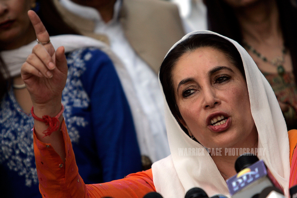 Former prime minister, Benazir Bhutto, speaks to media outside her residence on November 16, 2007, in Lahore, Pakistan. The government placed Bhutto under house arrest on Tuesday to prevent a mass-rally taking place from Lahore to Islamabad. Bhutto today was freed from house arrest after authorities lifted a seven-day detention order. Bhutto was assassinated after holding a political rally in Rawalpindi on December 27, 2007. (Photo by Warrick Page)
