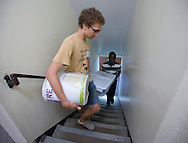 Karl Sadkowski (from left), 18, of Cedar Falls, Iowa and his roommate, Reggie Sackey-Addo, 17, of Accra, Ghana walk up the stairs as they carry a load of his belongings to their room at Grinnell College in Grinnell, Iowa on Saturday, August 25, 2012.