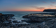 Panoramic of sunset transitioning to dusk at Curio Bay, Catlins, New Zealand