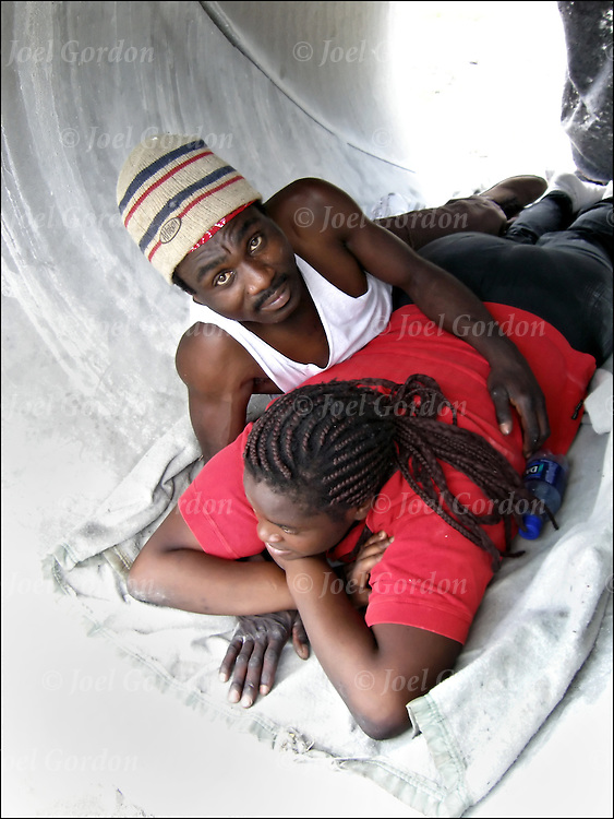 African American couple sleeping and living in water pipe, homeless, street people, living in large water pipe with girl friend who is pregnant,homeless on the streets  of Orlando.<br /> <br /> releases <br /> #1807 - Deidre Chambers<br /> #1808 - Carlton Brown