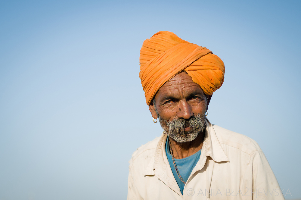 India, Rajasthan. Man from Thar desert wearing a typical orange turban on his head.