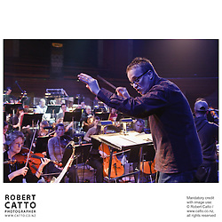 The Vector Wellington Orchestra with conductor Marc Taddei perform in concert with Che Fu and the Crates, at the Michael Fowler Centre in Wellington.
