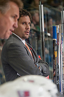 KELOWNA, CANADA - NOVEMBER 7: Scott Burt, Assistant Coach of the Spokane Chiefs stands on the bench against the Kelowna Rockets  on November 7, 2014 at Prospera Place in Kelowna, British Columbia, Canada.  (Photo by Marissa Baecker/Shoot the Breeze)  *** Local Caption *** Scott Burt;