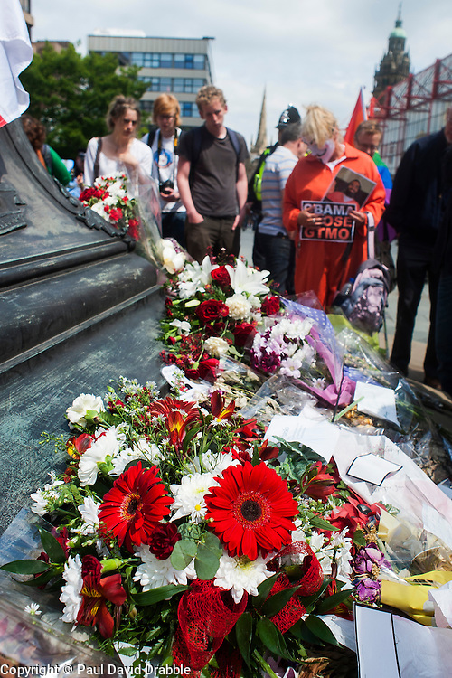 The English Defence League (EDL) return to Sheffield to lay flowers at Sheffield War Memorial which is fenced off to stop counter protesters occupying the whole of Barkers Pool. The area around Sheffield War memorial is opened is opened and anti EDL protester gather around where the flowers were laid <br /> <br /> 8 June 2013<br /> Image © Paul David Drabble<br /> www.pauldaviddrabble.co.uk
