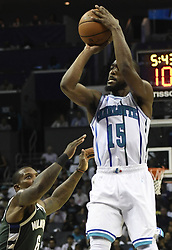 October 17, 2018 - Charlotte, NC, USA - The Charlotte Hornets' Kemba Walker (15) shoots over the Milwaukee Bucks defense in the second half at the Spectrum Center in Charlotte, N.C., on Wednesday, Oct. 17, 2018. The Bucks won, 113-112. (Credit Image: © David T. Foster Iii/Charlotte Observer/TNS via ZUMA Wire)