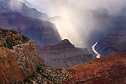 Rain falling near the Colorado River in the Grand Canyon.