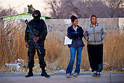 Federal Police patrol a slum in Juarez, Mexico January 15, 2009 after a drug related shooting killed four people. The shooting, believed linked to the ongoing drug war which has already claimed more than 40 people since the start of  the year. More than 1600 people were killed in Juarez in 2008, making Juarez the most violent city in Mexico.    (Photo by Richard Ellis)