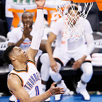 08 May 2016: Oklahoma City Thunder guard Russell Westbrook (0) goes for the layup during the Oklahoma City Thunder 111-97 victory over the San Antonio Spurs, during Game Four of the Western Conference Semifinals of the NBA Playoffs at the Chesapeake Energy Arena, Oklahoma City, Oklahoma, USA.