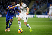 Leicester City midfielder Nampalys Mendy (24) and Burnley's Gudmundsson during the Premier League match between Leicester City and Burnley at the King Power Stadium, Leicester, England on 10 November 2018.
