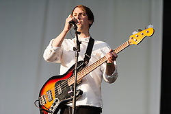 © Licensed to London News Pictures. 06/06/2015. London, UK.   Django Django performing live at Field Day Festival Saturday Day 1.  In this picture - Jimmy Dixon.  Django Django are a British art rock band composed of members  David Maclean (drummer and producer), Vincent Neff (singer and guitarist), Jimmy Dixon (bassist), and Tommy Grace (synthesizer)    Photo credit : Richard Isaac/LNP