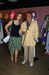 Artist DAISY DE VILLENEUVE and her father JUSTIN DE VILLENEUVE at a party to celebrate the opening of an exhibition by Daisy de Villeneuve at the Fashion and Textile Museum, Bermondsey Street, London SE1 on 25th June 2004.