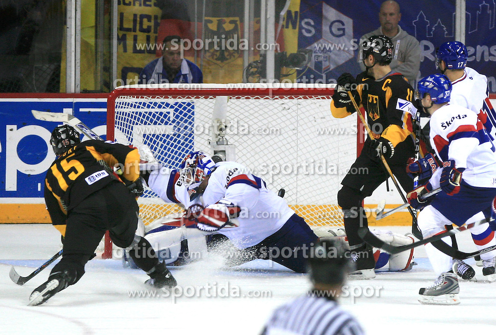 Stefan Ustorf of Germany and goalkeeper Jan Lasak of Slovakia at ice-hockey match Germany (played in old replika jerseys from year 1946) vs Slovakia at Preliminary Round (group C) of IIHF WC 2008 in Halifax, on May 05, 2008 in Metro Center, Halifax, Nova Scotia, Canada. Germany won 4:2. (Photo by Vid Ponikvar / Sportal Images)