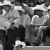 "Cowboys, and riders at the ""Plaza de toros"" tier,  drink beers and dance with the sound of the typical Mexican music, during one of the Oldest Bullfighting carnival in Latin America.  Every year since 1831 the people of Autlan, in the south west of Mexico celebrates a festivities before  the beginning of the Easter week."