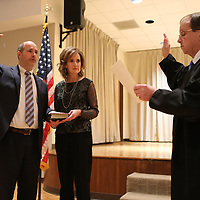 Bradley Tennison, left, takes the oath of office to become the next Chancery Judge from outgoing Chancery Judge John A. Hatcher Friday morning in Booneville.