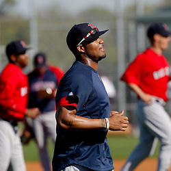 February 23, 2011; Fort Myers, FL, USA; Boston Red Sox left fielder Carl Crawford (13) runs with teammates during spring training at the Player Development Complex.  Mandatory Credit: Derick E. Hingle