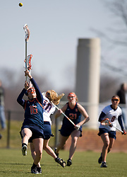 Syracuse Orange A Awehiyo Thomas (16) goes up for a loose ball with Virginia Cavaliers M Kaitlin Duff (10).  The #2 ranked Virginia Cavaliers women's lacrosse team defeated the #4 ranked Syracuse Orange 13-8 at the University of Virginia's Klockner Stadium in Charlottesville, VA on March 1, 2008.