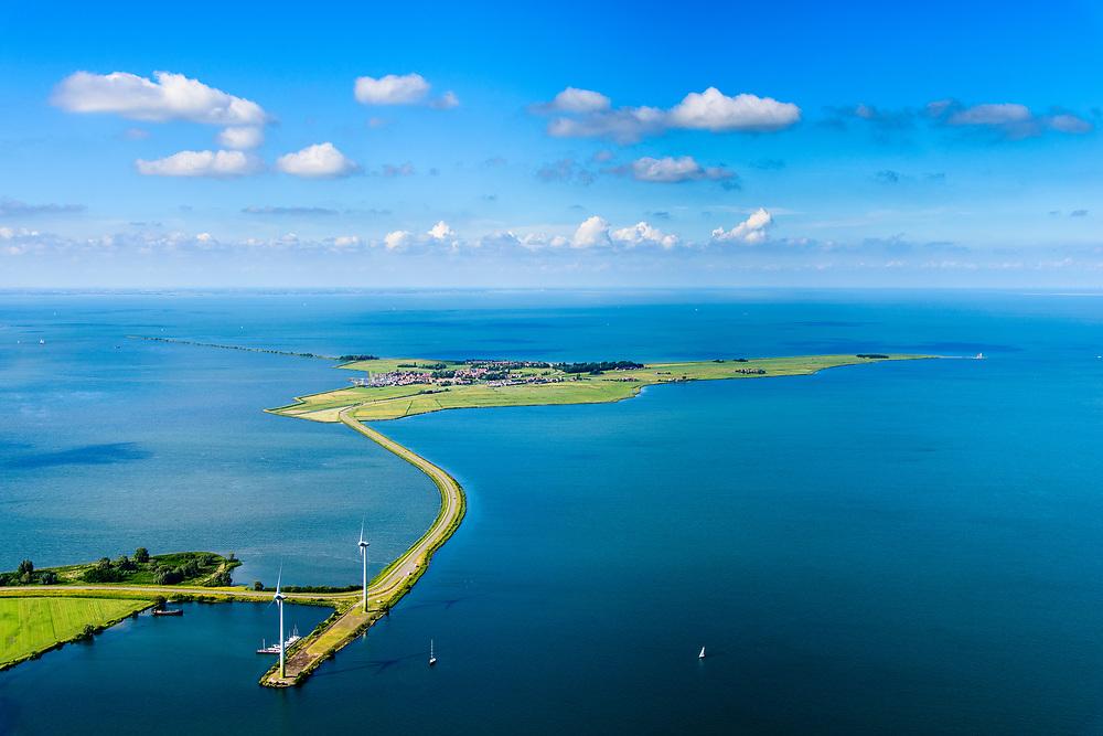 Nederland, Noord-Holland, Gemeente Waterland, 13-06-2017; het voormalig eiland Marken, nu met een dam verbonden met Waterland. Het omliggende water is het Markermeer (IJsselmeer, Zuiderzee). Gezien vanuit Zuiden, nabij Uitdam.<br /> The former island of Marken, now connected with a causeway (dam) to the mainland. <br /> luchtfoto (toeslag op standaard tarieven);<br /> aerial photo (additional fee required);<br /> copyright foto/photo Siebe Swart