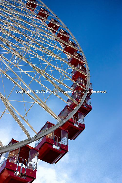 A view from the ground of some of the ferris wheel cars at Navy Pier