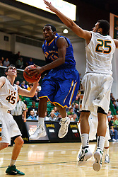 Nov 16, 2011; San Francisco CA, USA;  San Jose State Spartans guard James Kinney (33) shoots past San Francisco Dons forward Cole Dickerson (25) during the second half at War Memorial Gym.  San Francisco defeated San Jose State 83-81 in overtime. Mandatory Credit: Jason O. Watson-US PRESSWIRE